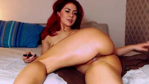 Redhead Plays With Her Red Dildo